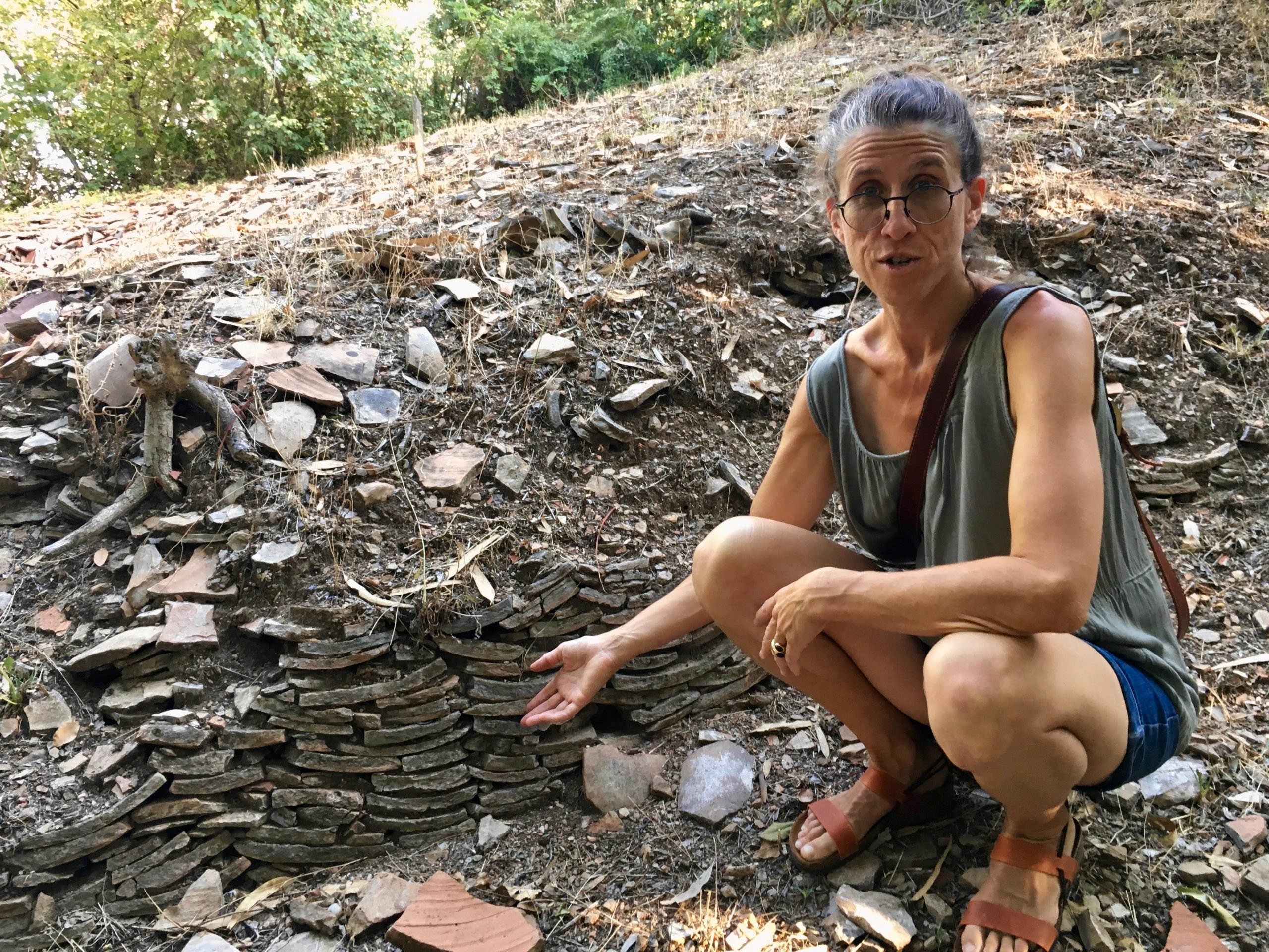 Monte Testaccio Rome Tour Daniella Hunt indicates the tightly packed and pile fragments of amphora along the path up the hill
