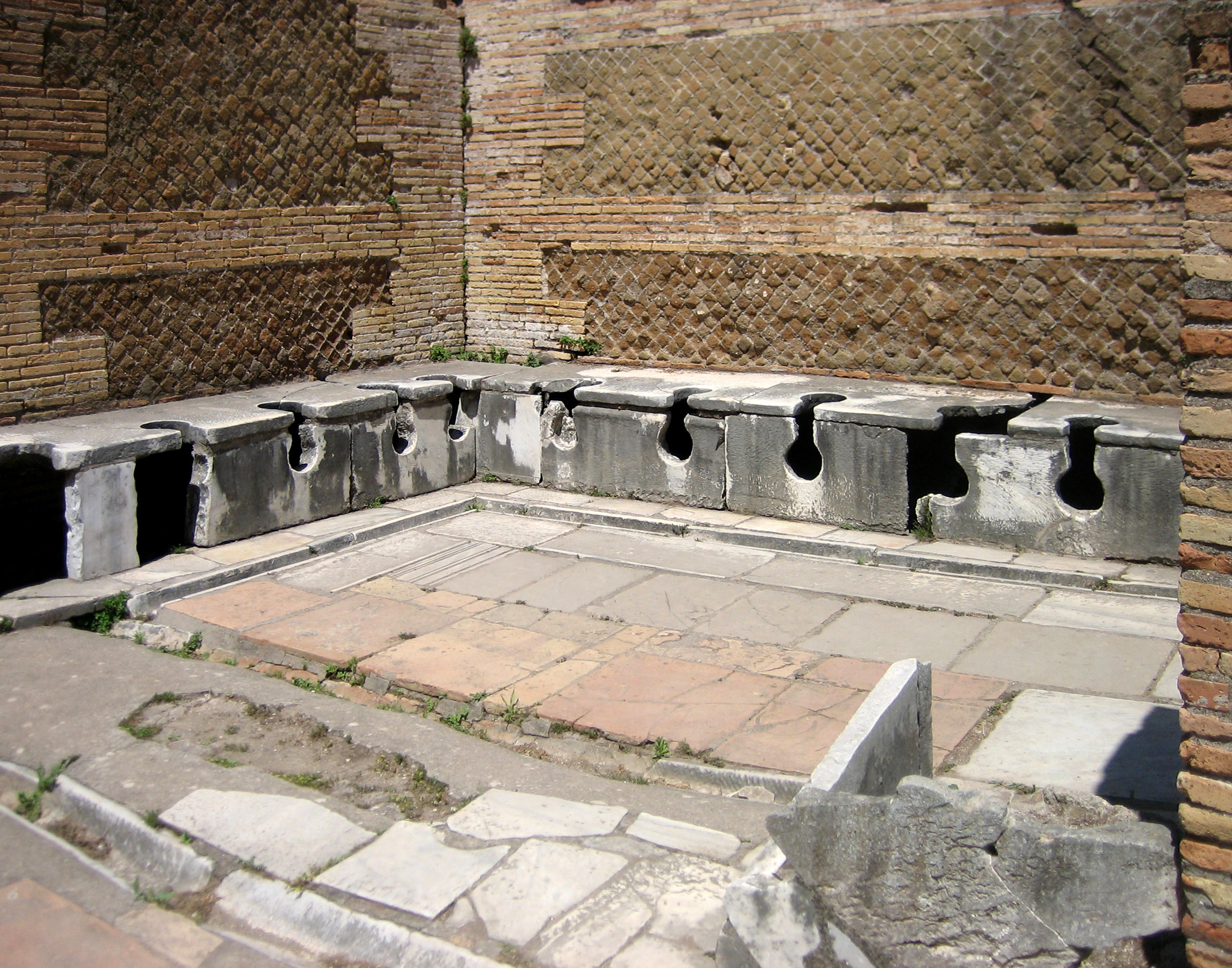 a semi-intact public toilet in the ancient city of Ostia Antica