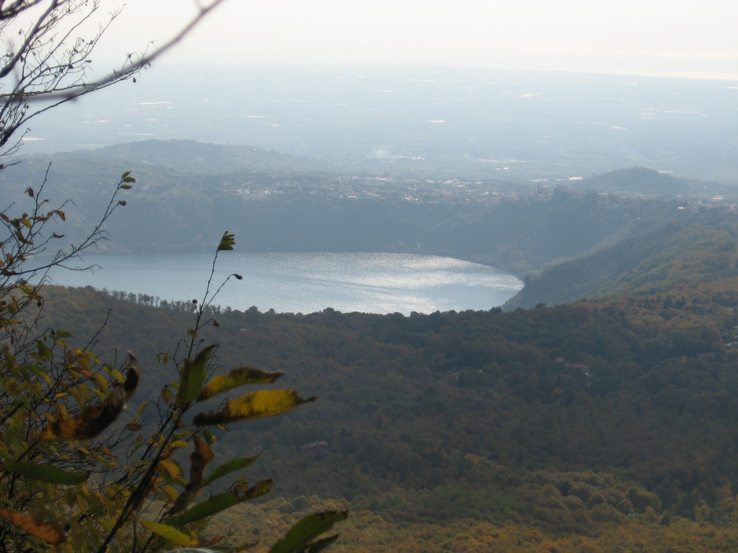 a view onto the lake of Nemi from the top of Monte Cavo, a mountain overlooking it