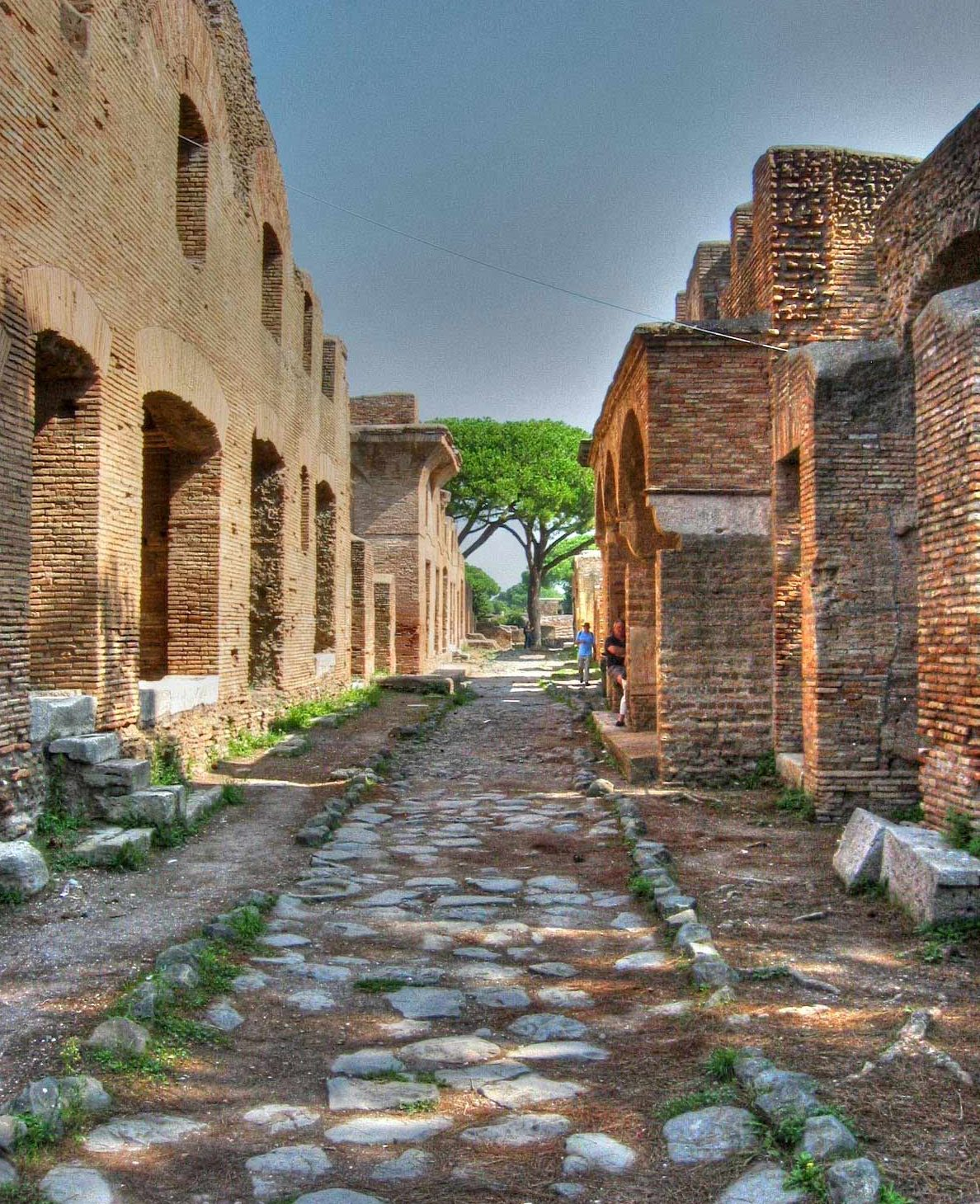 A road and apartment buildings in the ancient city of Ostia Antica