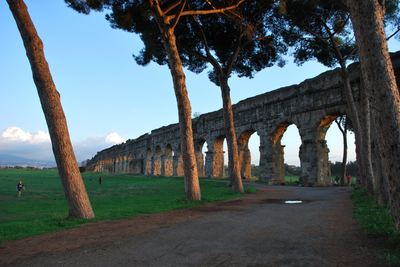 an ancient Roman acqueduct crosses the Park of the Acqueducts in Rome
